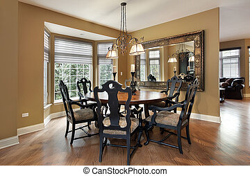 Dining room with gold walls