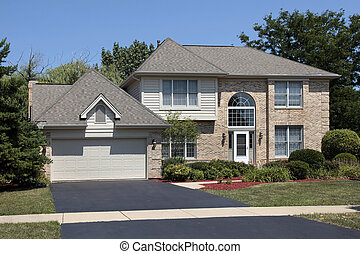 Brick home with arched front windows - Brick home in suburbs...