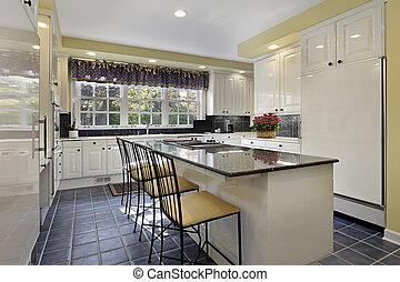 Kitchen with granite counter - Kitchen in suburban home with...