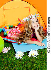 Children fashion little girl lying indoor of camping tent...