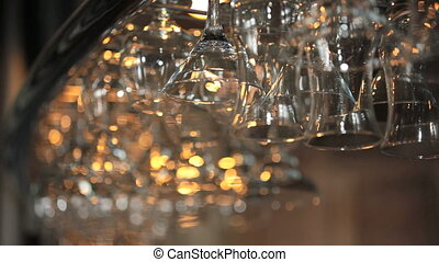 Wine glasses hanging upside down.