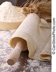 rolling pin and dough - dough,rolling pin and flour