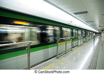 High-speed subway - A staff member standing at the subway...