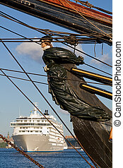 Old figurehead and new cruiseship - Old wooden figurehead...