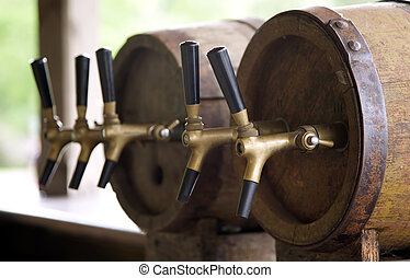 Wooden old barrels with pipe for beer - Wooden old barrels...