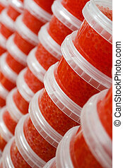 Red caviar in plastic container