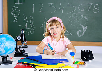 children little girl at school classroom with microscope in...