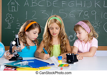 kids group of student girls at school classroom as children...