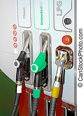 Gas station - Petrol diesel and auto gas nozzles at fuel...