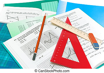 mathematics textbook, notebook, pencil and ruler closeup on...