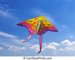 Kite in the sky - Brightly coloured kite is flying in the...