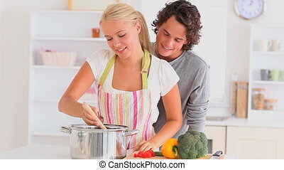 couple preparing their dinner in the kitchen