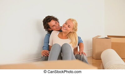 Couple enjoying being in their new livingroom in the new...