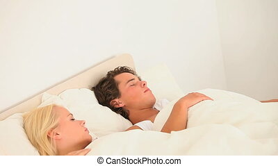 Cute happy couple assleep in the bedroom