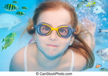 children girl underwater goggles swimming underwater with...