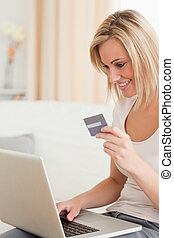 Portrait of woman buying online