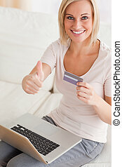 Close up of a cheerful woman buying online