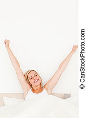 Portrait of a woman stretching her arms