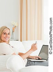 Portrait of charming woman paying her bills online