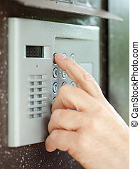 Close-up of using intercom - Close-up of person using...