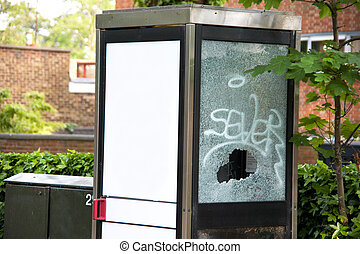 A smashed phonebooth, anti social behavior is quite on issue...