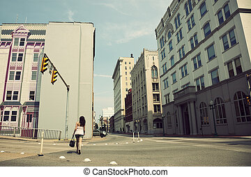 Girl walking streets of Charleston, West Virginia