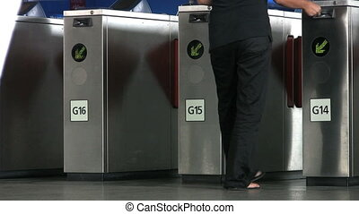 Sky Train Turnstile - People passing through electronic...