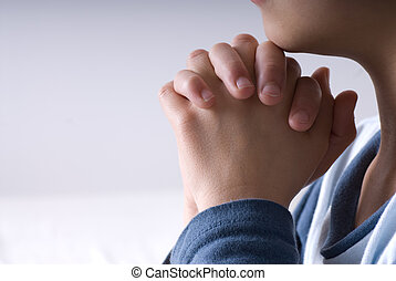 Praying hands - Small boy praying before going to bed