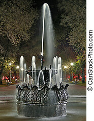 Old fountain at night in the park of Volgograd