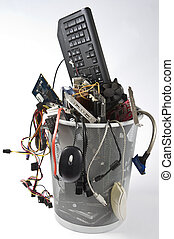 electronic scrap in trash can - trashcan in grey background...