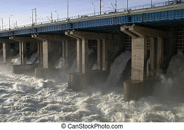 Volzhskaya dam - Water flowing over flood gates of a dam