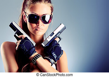 attractive - Shot of a sexy military woman posing with guns.