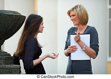 Young female students before exam - Two young female...