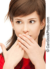teenage girl with palms over mouth - bright closeup portrait...