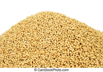 soy lecithin granules - a pile of soy lecithin granules on a...