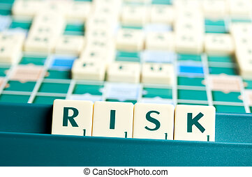 Risk word with scrabble pieces