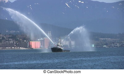 Tug Boat Spraying Water In The Harbor