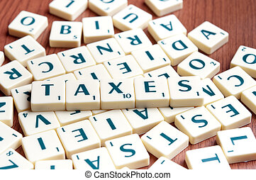 Taxes word with scrabble pieces
