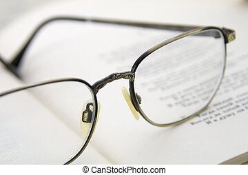 Glasses on the book Macro shoting