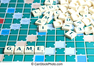 Game word with scrabble pieces