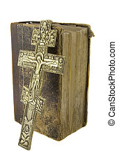 Very old vintage bible and big church cross near to it...