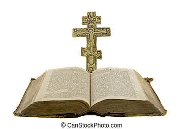 Very old vintage open bible and big church cross near to it isolated over white background