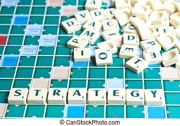 Strategy word with scrabble pieces