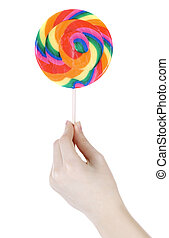 Hand holding lollipop isolated over white