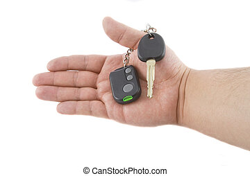 Hand holding key and car alarm system isolated on white...