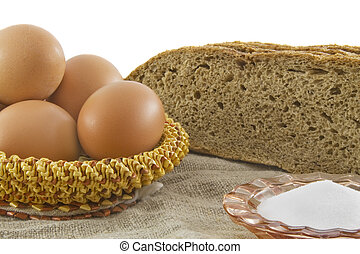 Still-life. Vegetarian products: rye bread from a flour of a...