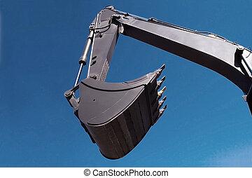 Shovel bucket against blue sky