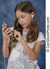 Young Girl Focused on Smart Phone Application - A young girl...