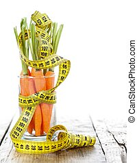 Carrot fitness - Cup with carrots and measure tape, place...