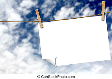 Paper sheet on a clothes line - Blank paper sheet on a...